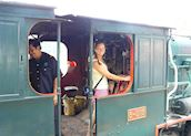 Nicki in the driving seat, North Borneo Railway, Borneo